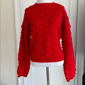 Cropped red bell sleeve sweater